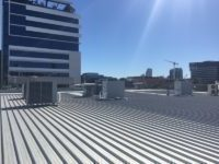 Air conditioners on a roof | LCM Air Conditioning