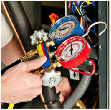Man checking pressure gauges | LCM Air Conditioning